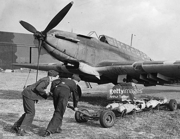 A Fairey Battle bomber plane being loaded up with 250pound general purpose bombs at an RAF station where pilots of the Royal Air Force and the Fleet...