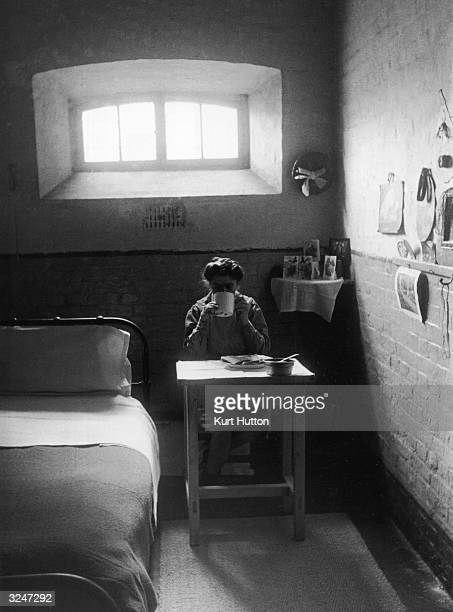 An inmate eats alone in her cell in Holloway Women's Prison north London Original Publication Picture Post 4425 Inside Holloway Prison pub 1947