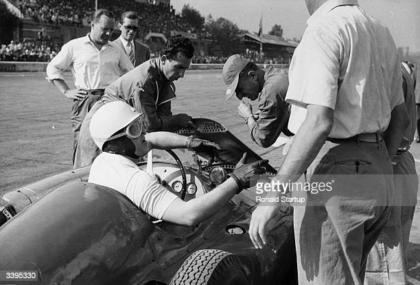 A racing driver and a group of mechanics in the pitstop at the Monza Grand Prix in Italy Original Publication Picture Post 6740 Ferrari's Last Race...