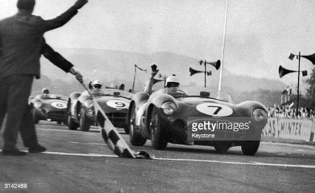Aston Martin cars winning the top three places in the Tourist Trophy Sports Car Race at Goodwood In first place Stirling Moss and Tony Brooks...