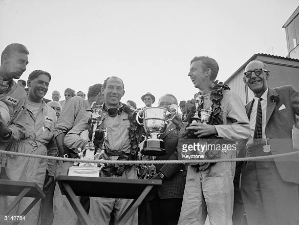 Stirling Moss and codriver Tony Brooks with the trophy after winning the Tourist Trophy Sports Car Race at Goodwood