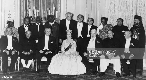 Queen Elizabeth II poses with the Commonwealth Ministers at a banquet in Buckingham Palace London From left to right the group includes Rashidi...