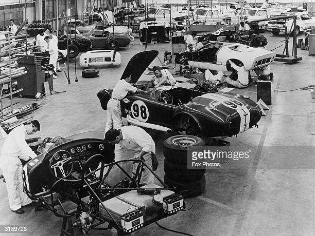 Mechanics on the production line at Shelby American Inc. In Los Angeles working on Cobra and Mustang GT 350 sports cars.