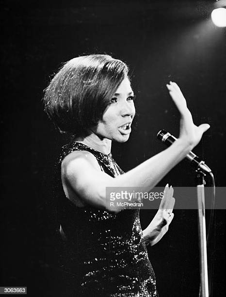 Welsh singer Shirley Bassey performs at the Pigalle nightclub in London