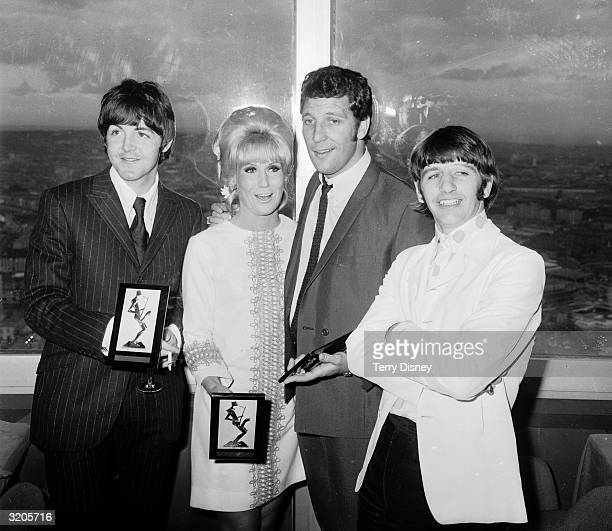 Paul McCartney Dusty Springfield Tom Jones and Ringo Starr with their awards at the Melody Maker Pop Poll luncheon in the GPO Tower restaurant
