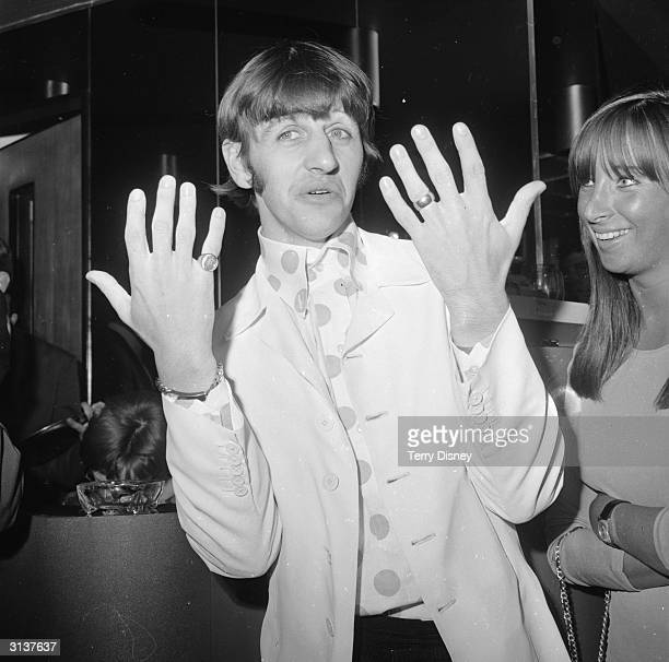 RIngo Starr the drummer for the Beatles shows off his jewellery during a Melody Maker pop poll luncheon in the GPO tower restaurant London