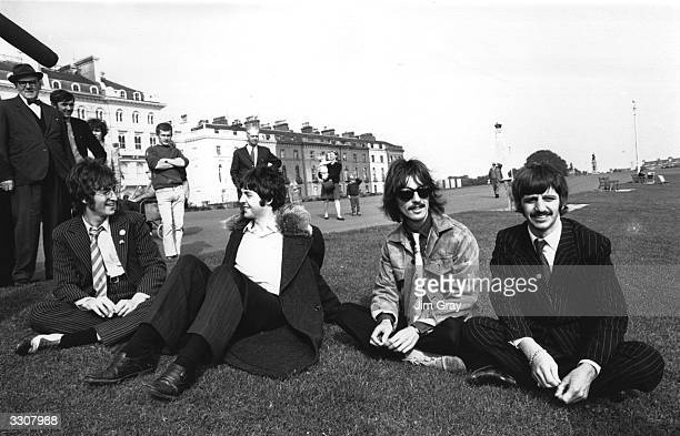 British rock group The Beatles John Lennon Paul McCartney George Harrison and Ringo Starr take a break during the filming of 'The Magical Mystery...