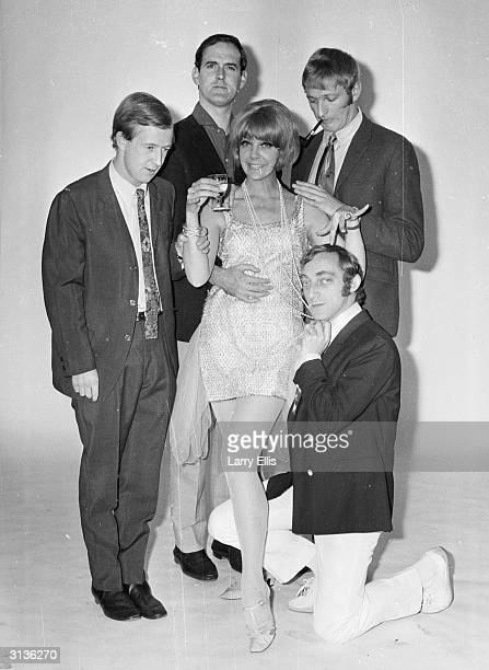 English comedians Tim BrookeTaylor John Cleese Graham Chapman and Marty Feldman with Aimi McDonald a dancer and the cohost of the 'At Last the 1948...