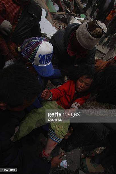 Year girl is rescued from the rubble following a strong earthquake on Jiegu township of China's Qinghai province on April 16, 2010 in Golmud, China....