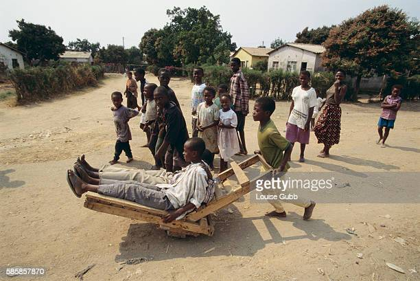 A 13yearold boy pushes his friends around in his barrow during a break from his work as a barrow boy He became the breadwinner of his family when...
