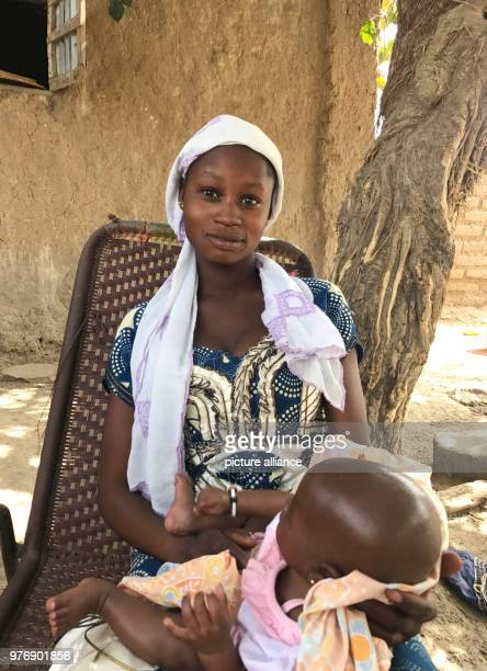 13yearold girl Minata from central Mali holds her twoandahalfmonthold baby in M'Pentièrébougou Mali 20 March 2018 Minata said she was 12 years old...