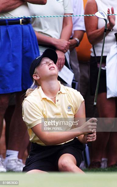 13yearold golfer Morgan Pressel of the United States reacts after her chip shot nearly went in the cup on the 14th hole 1 June 2001 during the second...