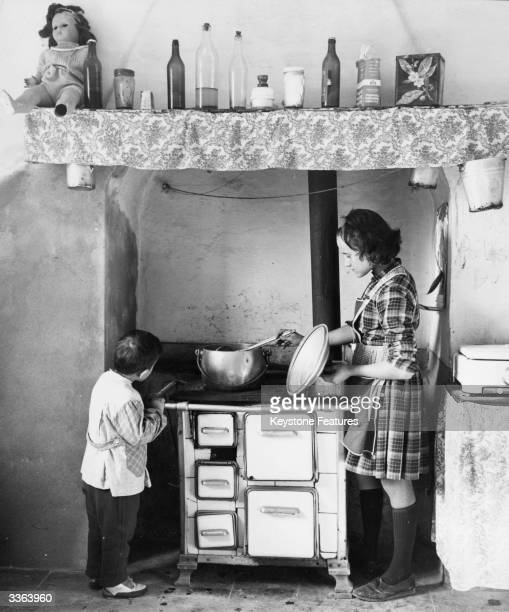13yearold Maria Gatto does the cooking and housework for her father and six siblings since the death of their mother The family live in Noale in...