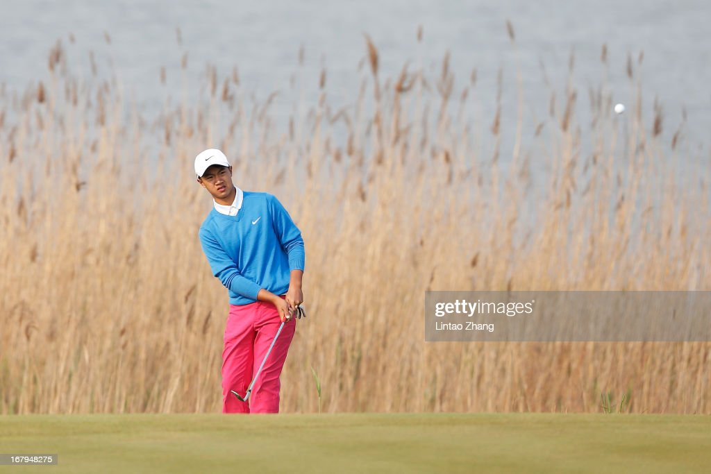 13-year-old Ye Wo-cheng of China plays a shot during the second day of the Volvo China Open at Binhai Lake Golf Course on May 3, 2013 in Tianjin, China.