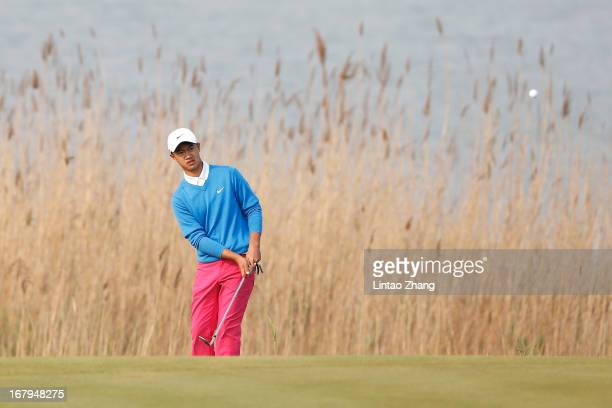 13yearold Ye Wocheng of China plays a shot during the second day of the Volvo China Open at Binhai Lake Golf Course on May 3 2013 in Tianjin China