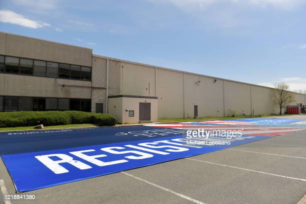 A 140foot banner created by the Rose Brand company is displayed as a rallying point in the company's parking lot on April 14 2020 in Secaucus New...