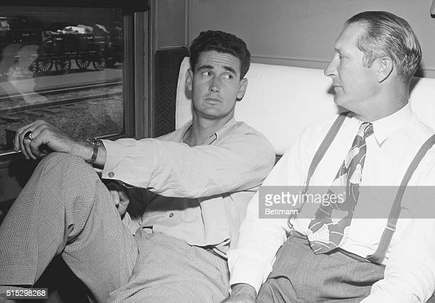 14/11/48Atlanta GA Ted Williams Boston Red Sox slugger and coach Paul Schreiber wear worried looks as the train stops at Atlanta enroute from New...