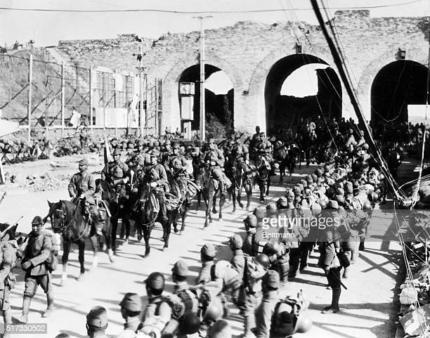 Nanking, China: An impressive picture made as Japanese infantry and cavalry troops marched through the triple arched chungsun gate that leads to...