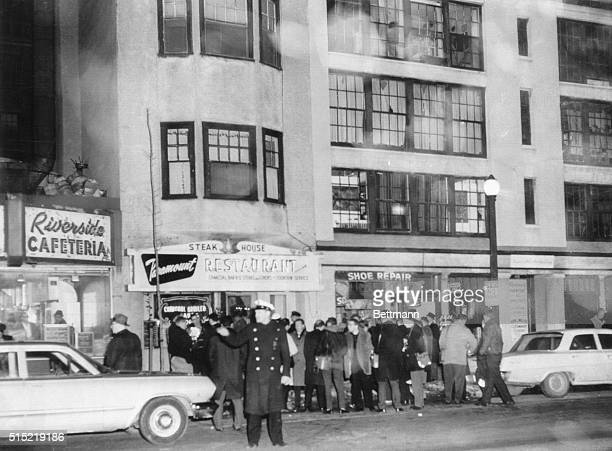 1/4/1964Boston Massachusetts Newsmen and photographers gather in front of the entrance to the apartment where Mary A Sullivan of Hyannis MA was found...