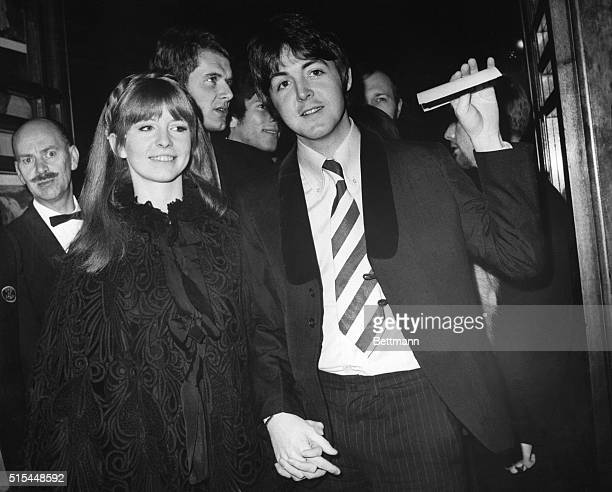 1/4/1968London England Beatle Paul McCartney and actressgirlfriend Jane Asher arriving at the London Pavillion for the world premiere of Here We Go...