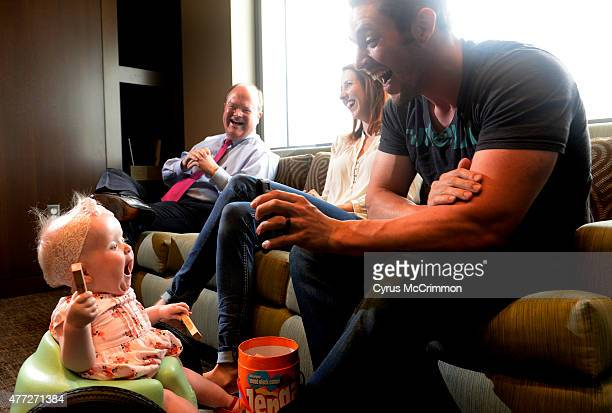 14monthold Emma Gilstrap keeps everyone entertained including mom and dad Ariel center and Mark Gilstrap right and Dr Timothy Crombleholme on Monday...
