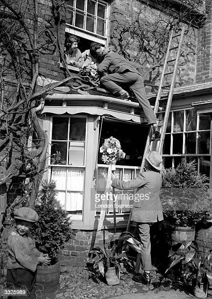 On Hungerford annual 'Tutti' day a young man climbs up to an open window to claim his kiss from the girls within or receive a payment in forfeit