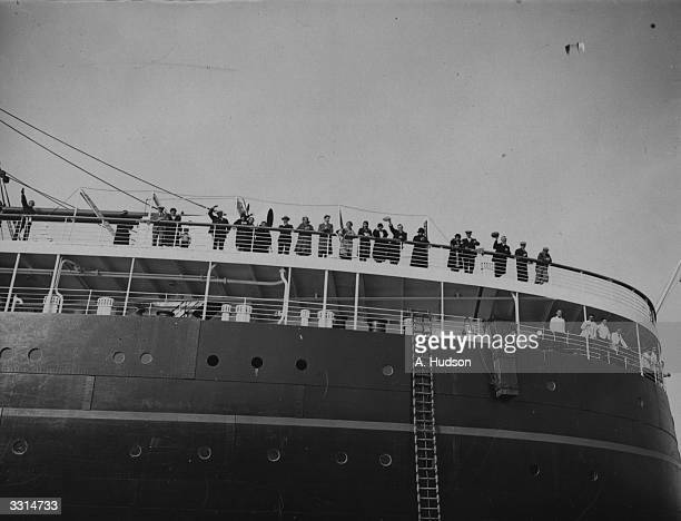 Passengers waving from the deck of the liner 'Statendam' after it ran aground on a mud bank at the entrance to Southampton water