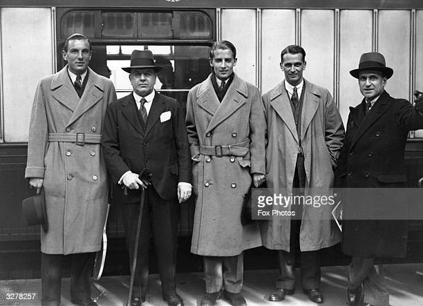 British Davis Cup players Fred Perry Henry Roper Barrett Bunny Austin Lee and Sabbelli at Victoria Station London before leaving to go to Spain