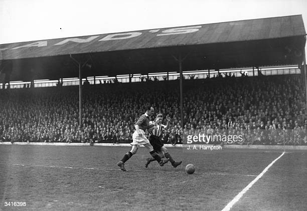 Jack Carey of Manchester United and Ireland tackling a Brentford player during a match at Brentford's ground Griffin Park in London