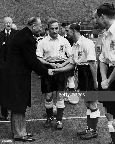 The Duke of Gloucester shakes hands with Bill Eckersley as he is introduced to the players of the England football team by captain Billy Wright...