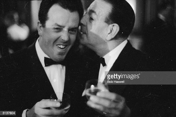 British comedy actor Ronald Shiner shares a joke with fellow entertainer Brian Rix