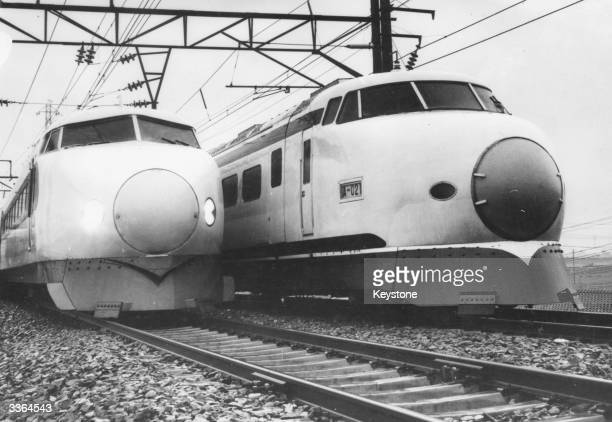 Two of Japan's newly-designed electric bullet trains which maintain a speed of 125 miles per hour.