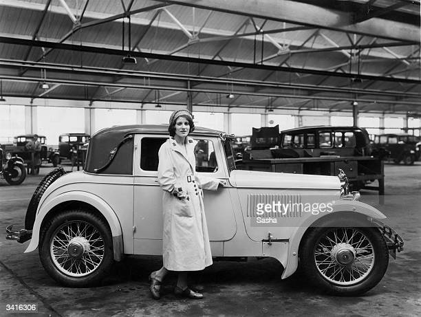 Female motorist Paddie Naismith, occasional chauffeur for Prime Minister Ramsay MacDonald, standing next to her Avon Standard 'Little Nine'.
