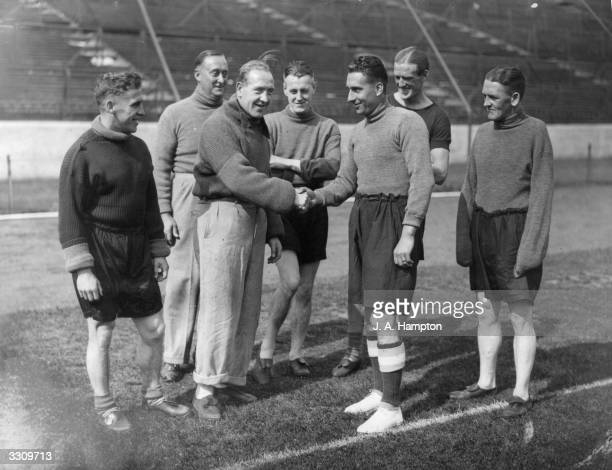 Sam Weaver is greeted by Tommy Law and his other new colleagues at Chelsea after his transfer from Newcastle United