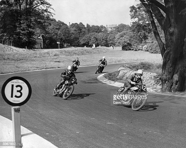 Oliver leads the field on his Norton during the Crystal Palace Trophy Race for Motorcycles on the Crystal Palace Road Racing Circuit.
