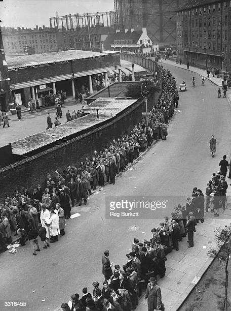 Crowd of cricket spectators queuing outside the Kennington Oval, London.