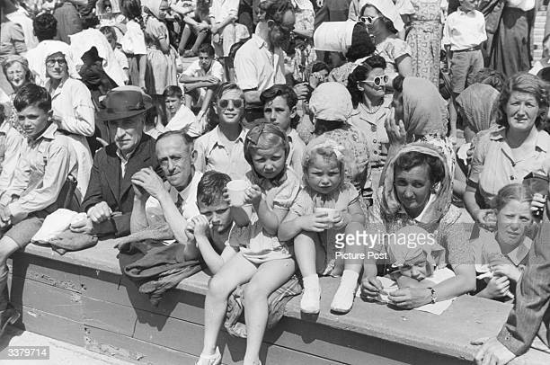 A section of the crowd watching the 1948 London Olympics in the summer heat at Wembley Stadium London Original Publication Picture Post 4582 Olympic...