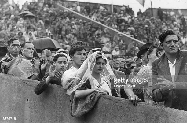 Crowds watching the 1948 London Olympics in the rain at Wembley Stadium Original Publication Picture Post 4582 Olympic Games pub 1948