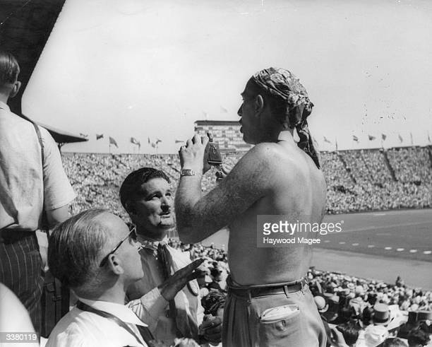 One of the Argentine competitors at the 1948 London Olympics photographing a section of the crowd at Wembley Stadium Original Publication Picture...