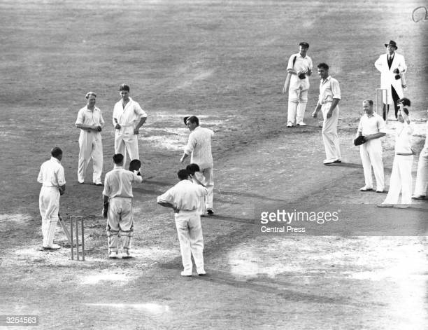 The England Captain leads the team in a special cheer for Don Bradman the Australian Captain who is playing his last Test Match at the Oval Sir...