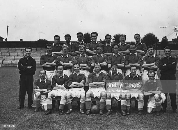 The players and coaching staff of Watford Football Club comprising from left to right from the back row of D Small C Taylor T Collins R Sherwood K...