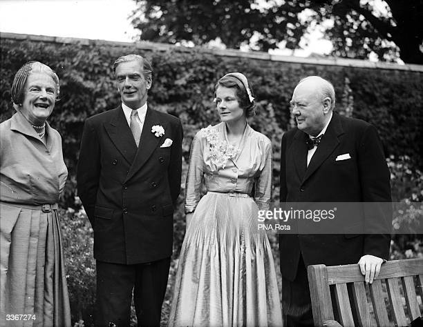 British Prime Minister Winston Churchill and his wife Clementine pose with the bride and groom at the wedding of Foreign Secretary Anthony Eden and...