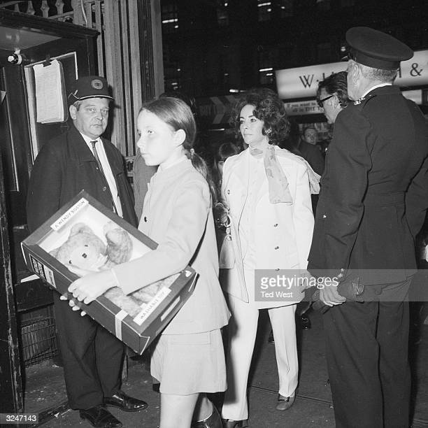 Actress Elizabeth Taylor boards a train at London's Waterloo Station bound for Southampton where she will catch the transatlantic cruise liner Queen...