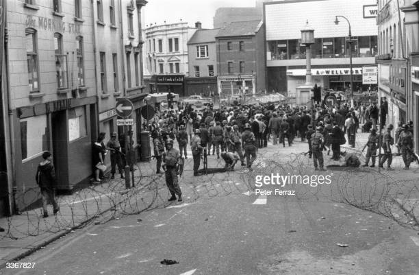 British troops intervene in rioting during the Battle of the Bogside in Derry city