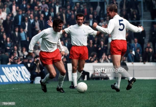 14th August 1971 Maine Road Manchester Manchester City v Leeds United Leeds United defender Norman Hunter sweeps up in front of teammates Jack...
