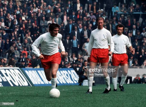 14th August 1971 Maine Road Manchester Manchester City v Leeds United Leeds United's Norman Hunter sweeps up at the back as he is watched by...