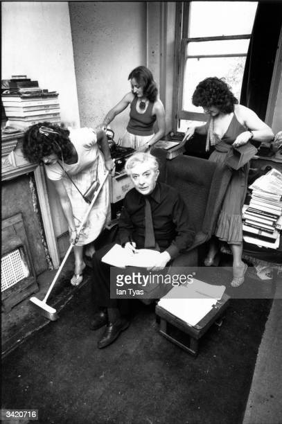At home in Chelsea, Quentin Crisp has plenty of helpers with the housework.