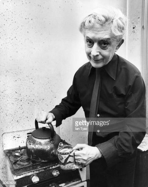 British author Quentin Crisp makes a last pot of tea in the Chelsea bed-sitting room, where he has lived for 41 years, before his move to New York.