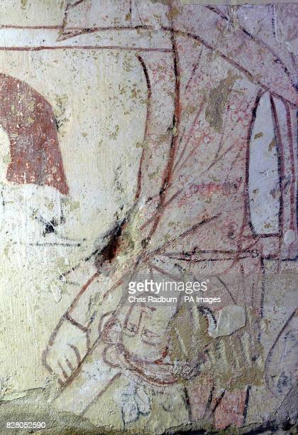 A 14th century wall painting showing a fallen king that was discovered during renovation work near Beccles Suffolk The paintings were first...