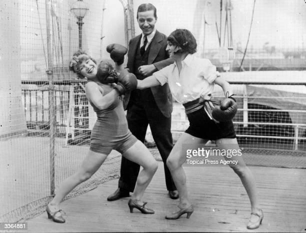 A man watching two women mockboxing